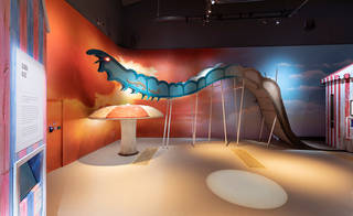 Gallery display showing a giant caterpillar rollercoaster