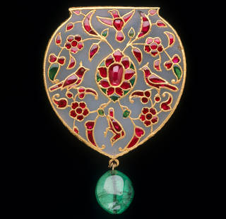 Green jade pendant set with rubies and emeralds in the shapes of flowers and birds with a large green emerald drop at the bottom