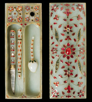 White nephrite jade pen box with utensils set with rubies, emeralds and diamonds in gold in the shapes of flowers , petals and leaves.