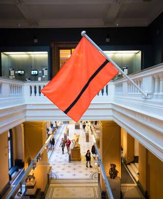 Orange flag with a black line through it