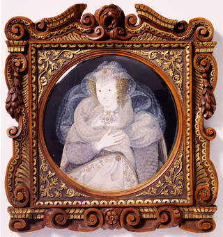 Painted portrait of a woman in cream, elaborate, lace clothing and headpiece with jewels with her hand held to her left breast. In a wooden frame decorated with gold leaves.