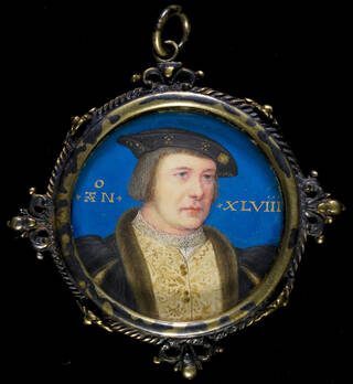 Portrait of a man in a round frame with blue background. Man wears a fur collar and gold brocade waistcoat with black and gold hat.