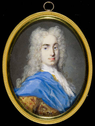 Oval portrait miniature of man with long grey wig, blue sash on right shoulder and gold coat.