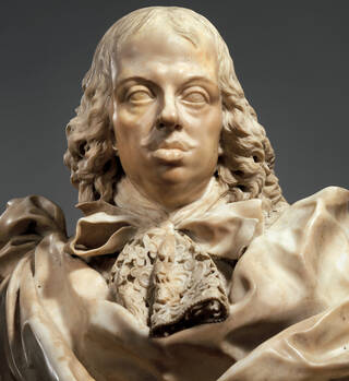Pale marble bust of a man wearing a detailed lace cravat