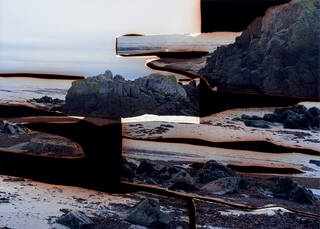 Landscape image comprised of layered sections of beach, rocky shore, sea and sky.