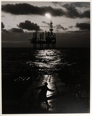 North Sea oil rig with a cloudy sky