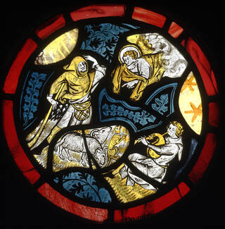 Roundel showing the Annunciation of the Shepherds, with details in silver stain.