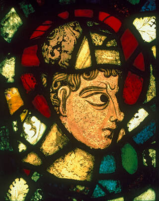 Stained glass depicting the Head of a Patriarch.