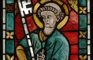 Detail from a panel depicting Saint Peter in red yellow and green stained-glass.