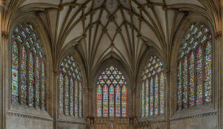 Interior of Wells Cathedral, Lady Chapel showing several large stained-glass windows