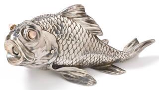 Silver cigar cutter in the shape of a carp