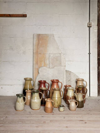 Group of ceramic jugs on the floor