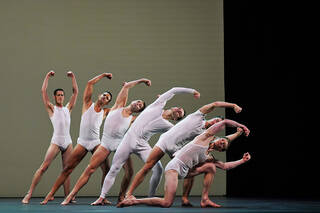 Male dancers in white underwear and vests