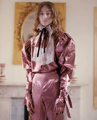 Model wearing Harris Reed ensemble