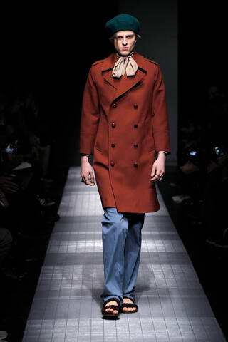 Catwalk model wearing Gucci coat